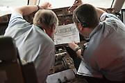 Crew of cargo plane controlled by the DGCA (Directorate General of Civil Aviation) in Roissy- Paris France. The DGCA has the power to forbid a plane to take off and force passengers to disembark if a threat to flight safety is detected.<br /> <br /> <br /> Avion de fret controlé par la DGAC (Direction générale de l'aviation civile) à Roissy. la DGAC a le pouvoir d'empêcher un avion à décoller et obliger les passagers à débarquer si une menace sur la sécurité du vol est détectée.