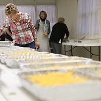 Dr. Roma Taylor labels the finished pans before moving onto the next dish as she and other volunteers help begin cooking for the annual Thanksgiving day dinner Monday morning.