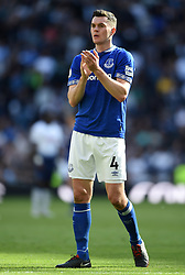 Everton's Michael Keane applauds the away fans at full time