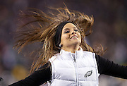 A Philadelphia Eagles cheerleader flips her hair as she cheers during the NFL NFC Wild Card football game against the New Orleans Saints on Saturday, Jan. 4, 2014 in Philadelphia. The Saints won the game 26-24. ©Paul Anthony Spinelli