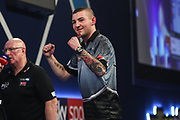 Nathan Aspinall reacts to winning his first leg of the match during the World Darts Championships 2018 at Alexandra Palace, London, United Kingdom on 30 December 2018.