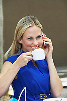 Woman Talking on a Cell Phone in a Coffee Shop