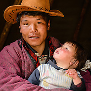 Dukha (Tsaatan) reindeer herder with his daughter, Mongolia. Approximately 200 families comprise the Tsaatan or Dukha community in northwestern Mongolia, whose existence is intimately linked to their herds of reindeer. Photo © Robert van Sluis