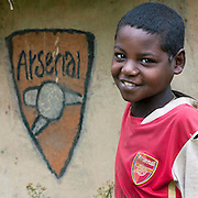 The football stars of tomorrow<br /> <br /> Thousands of Football shirts of Arsenal, Manchester, Chelsea, Milano, etc end up their carreer in... Ethiopia. Sold in the deep south, in the Omo Valley, those second hand clothes are bought by the local tribes. Most of them ignore the meaning of those shirts, and just buy them for the color, the logo, or the shape.<br /> No warrior will go out without his little pillow/seat.<br /> Some, like in Hamer tribe wear at the top of the head a clay helmet where they can put some ostrich feathers when they make a special action, like killing a wild animal, or...a man.<br /> Those tribes won't exist in few years as the ethiopian governement has launched a huge plan to develop the area.<br /> Soon, a highway coming from Mombassa - Nairobi will pass thru the villages to reach Addis Ababa.<br /> <br /> Photo shows: Arsenal Supporter Young Boy Omo Valley Ethiopia<br /> ©Eric Lafforgue/Exclusivepix Media