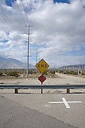 dead end road in an industrial dessert landscape California USA