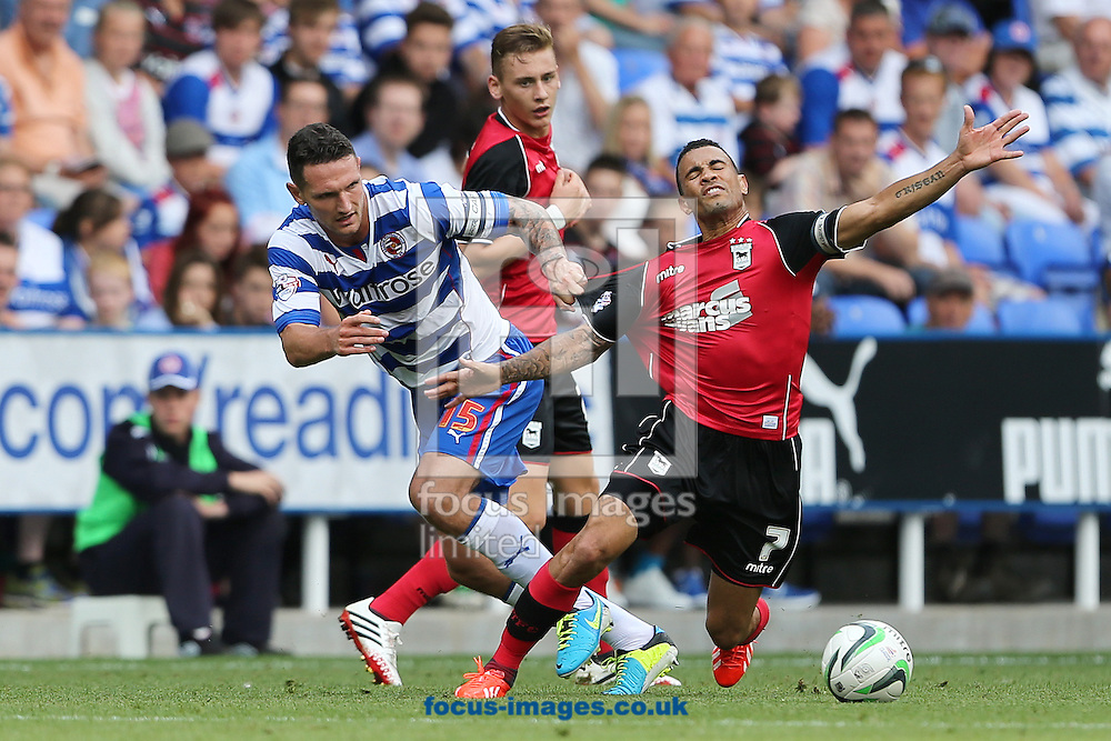 Picture by Richard Calver/Focus Images Ltd +447792 981244<br /> 03/08/2013<br /> Sean Morrison of Reading and Carlos Edwards of Ipswich Town during the Sky Bet Championship match at the Madejski Stadium, Reading.