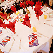 Brochures of the Red Arrows, Britain's RAF aerobatic team lay on a formal fundraising lunch during an airshow day.