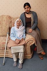 Granddaughter sitting with her Sikh elderly grandmother,