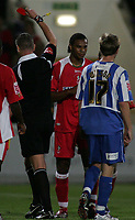 Photo: Paul Thomas.<br /> Chester City v Swindon Town. Coca Cola League 2. 01/09/2006.<br /> <br /> Jerel Ifel of Swindon (C) is shown a red card by Referee Mr D Foster after getting two yellows.