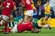 Twickenham, Great Britain,  David POCOCK, slooks for an outlet pass as he's tackled by Paul JAMES of Wales, during the Pool A game, Australia vs Wales.  2015 Rugby World Cup,  Venue, Twickenham Stadium, Surrey, ENGLAND.  Saturday  10/10/2015.   [Mandatory Credit; Peter Spurrier/Intersport-images]