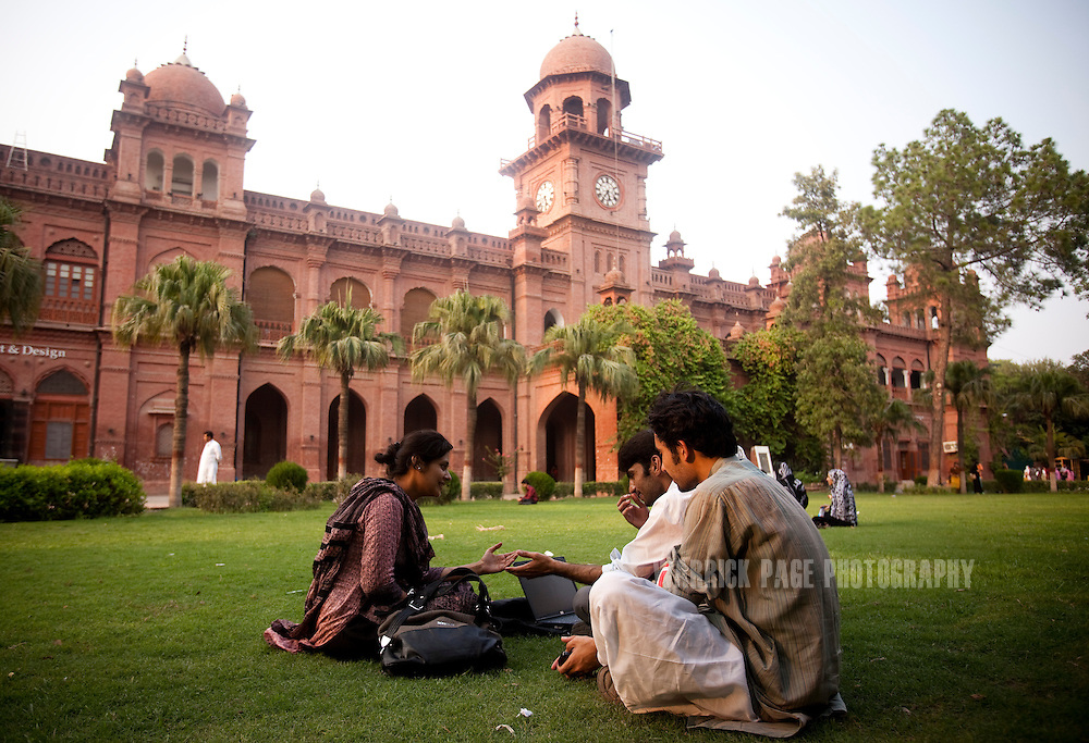 LAHORE, PAKISTAN - JULY 6: Male and female students talk outside on the lawn of Punjab University's old campus on July 6, 2011, in Lahore, Pakistan. Islamic groups are using increasing intimidation tactics in universities against progressive liberal youth throughout universities in Pakistan.  (Photo by Warrick Page)