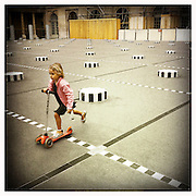 10-5-11 --- A young girl plays around the Les Deux Plateaux, most known as the Colonnes de Buren, in the courtyard of Palais-Royal.