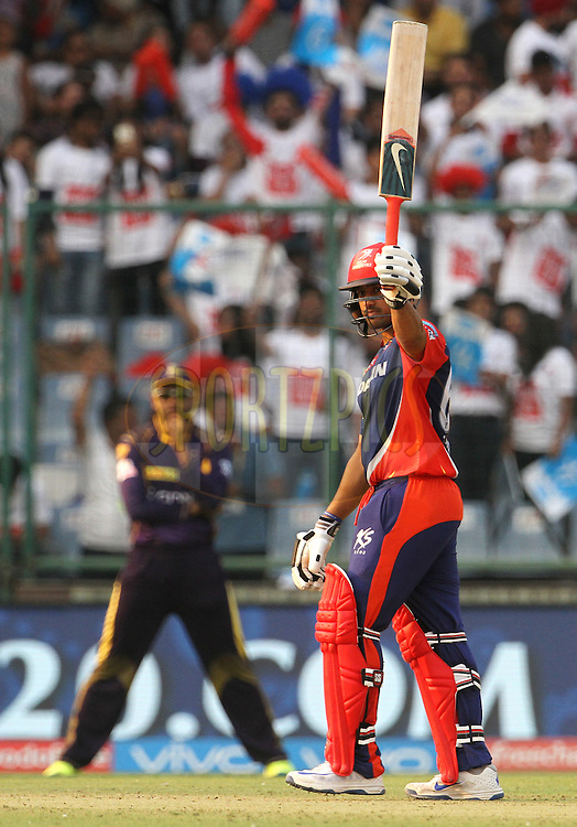 Delhi Daredevils player Karun Nair raises his bat after scoring a fifty during match 24 of the Vivo Indian Premier League ( IPL ) 2016 between the Mumbai Indians and the Kolkata Knight Riders held at the Wankhede Stadium in Mumbai on the 28th April 2016<br /> <br /> Photo by Vipin Pawar / IPL/ SPORTZPICS