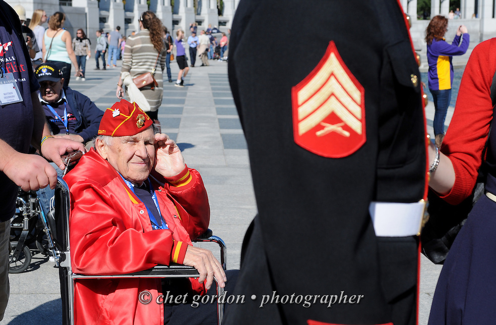 WWII Veteran Marine Nunzio Franchi (left) views an active duty Marine Sgt. in dress blues at the WWII Memorial in Washington, DC on Saturday, October 18, 2014. Seventy-five WWII Veterans from the Westchester County area toured the WWII Memorial and Arlington National Cemetery onboard the inaugural flight from Westchester County Airport in White Plains, NY. Hudson Valley Honor Flight is a chapter of the Honor Flight Network, which provides free flights for WWII Veterans and tours of the WWII Memorial constructed in their honor, and other sites in the nation's capital.  © www.chetgordon.com