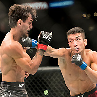 Ricardo Ramos (black trunks) defeated Kyung Ho Kang (maroon trunks) in a featherweight bout at UFC 227 held at the Staples Center in Los Angeles on August 4, 2018. Photo by Todd Bigelow for ESPN.