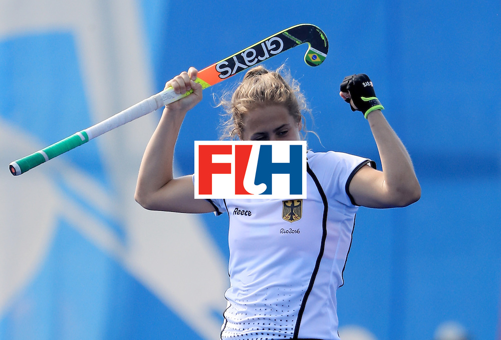 RIO DE JANEIRO, BRAZIL - AUGUST 15:  Marie Mavers #23 of Germany celebrates after defeating the United States in a quarterfinal match at Olympic Hockey Centre on August 15, 2016 in Rio de Janeiro, Brazil.  (Photo by Sam Greenwood/Getty Images)