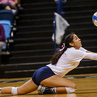 Window Rock Scout Kymberly Pablo (1) dives after a serve from the Ganado Hornets Tuesday at the Window Rock Event Center.