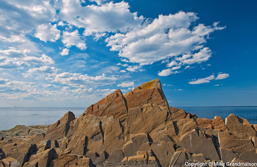 Low tide revealing the rocks along the Gulf of St. Lawrence, Pointe-A-La-Fregate, Quebec, Canada