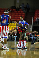"05 May 2006: Keiron 'Sweet P' Shine watches on as Kevin ""Special K"" Daley looses his shorts at the Harlem Globetrotters vs the New York Nationals at the Sulivan Arena in Anchorage Alaska during their 80th Anniversary World Tour."