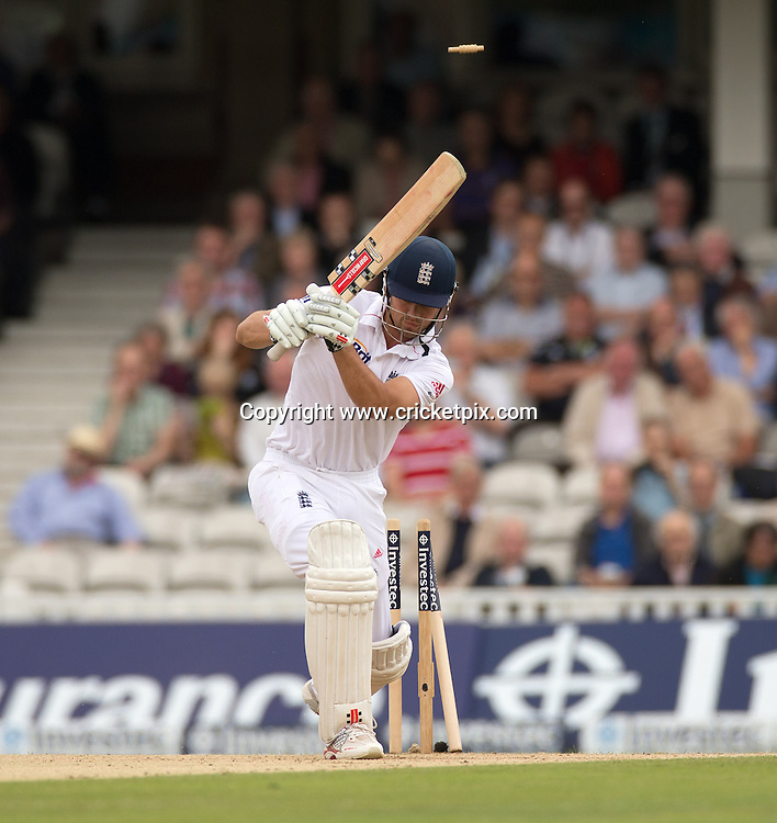 Alastair Cook is bowled by Dale Steyn for 115 during the first Investec Test Match between England and South Africa at the Brit Oval, London. Photo: Graham Morris (Tel: +44(0)20 8969 4192 Email: sales@cricketpix.com) 20/07/12