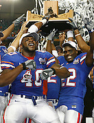 Florida's Brandon Siler and Reggie Lewis celebrate with the SEC trophy after the SEC Championship game between the Arkansas Razorbacks and the Florida Gators at the Georgia Dome in Atlanta, GA on December 2, 2006.<br />