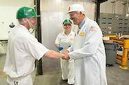 Bob Simpson, President and COO of Jelly Belly talks with some employees on the factory floor in Fairfield, Calif..