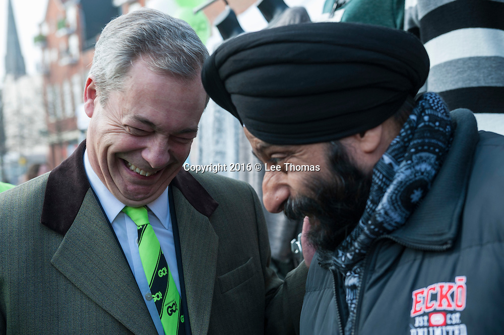 Romford, Essex, UK. 12th March, 2016. Ukip's Nigel Farage takes his Brexit campaign to Romford Market in Essex. Farage and his entourage walked through the Market Square in the centre of Romford talking to local residents. Pictured: Farage meets local stall holders in Market Square, Romford. // Lee Thomas, Flat 47a Park East Building, Bow Quarter, London, E3 2UT. Tel. 07784142973. Email: leepthomas@gmail.com. www.leept.co.uk (0000635435)