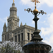 Fountain in City Hall Park with the Manhattan Municipal Building in background, New York City, New York