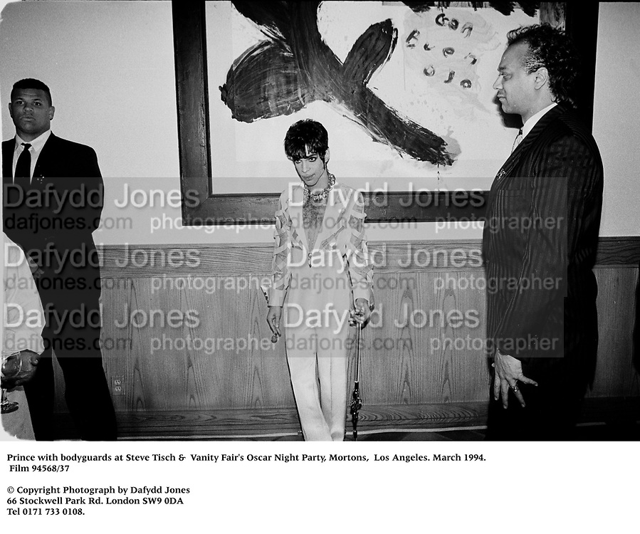 Prince with bodyguards at Steve Tisch &amp;  Vanity Fair's Oscar Night Party,<br />Mortons,  Los Angeles. March 1994.  Film 94568/37<br /> <br />&copy; Copyright Photograph by Dafydd Jones<br />66 Stockwell Park Rd. London SW9 0DA<br />Tel 0171 733 0108.