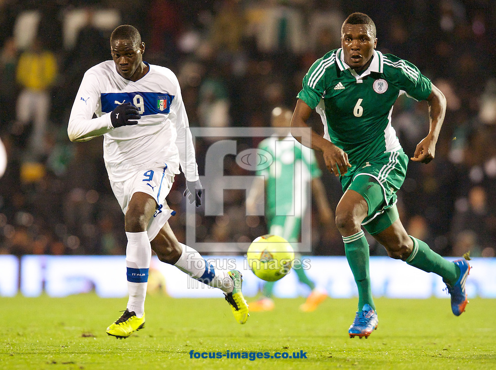 Picture by Alan Stanford/Focus Images Ltd +44 7915 056117<br /> 18/11/2013<br /> Mario Balotelli of Italy and Azubuike Egwuekwe of Nigeria during the International Friendly match at Craven Cottage, London.