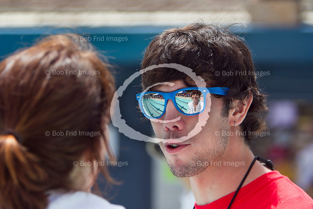 11 and 12 June 2011: The face of Kigoos official Diane Ball is reflected in the sunglasses of Richmond Kigoos Head Coach Benji Hutton.  52nd Annual Ice Breaker Swim Meet  held at Steveston Swimming Pool in Richmond, BC.   ****(Photo by Bob Frid/Freemotionphotography.ca) All Rights Reserved : cell 778-834-2455 : email: bob.frid@shaw.ca ****