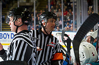 KELOWNA, CANADA - FEBRUARY 2: Linesman Cody Wanner stands at the bench with referee Jeff Ingram speaking to the coach of the Kelowna Rockets against the Kamloops Blazers  on February 2, 2019 at Prospera Place in Kelowna, British Columbia, Canada.  (Photo by Marissa Baecker/Shoot the Breeze)