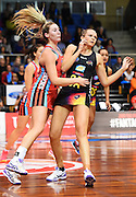L-R Tactix player Zoe Walker and Magic player Joanna Harten during their ANZ Netball Championship game Mainland Tactix v Cold Power Magic. Trafalgar Centre, Nelson, New Zealand. Sunday 14 May 2016. ©Copyright Photo: Chris Symes / www.photosport.nz