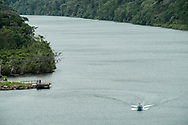 A small motor boat on the Chagres River, Panama. (Model Released)