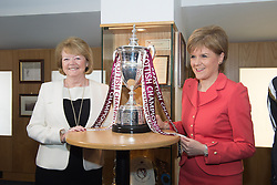 © Licensed to London News Pictures. 26/05/2015. L to R Heart of Midlothian Football Club Chairwoman and Chief Executive Ann Budge and First Minister Nicola Sturgeon pose with the Scottish Championship cup during a visit to winners of the Scottish Championship, Heart of Midlothian Football Club where Nicola Sturgeon delivered her first first economic speech since the general election. Photo credit: Max Bryan/LNP
