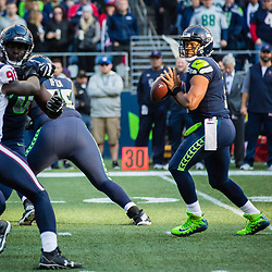 SEATTLE, WASHINGTON - OCTOBER 29: Seattle Seahawks quarterback Russell Wilson (3) drops back for a pass against the Houston Texans at CenturyLink Field in Seattle, WA. (Christopher Mast/Seattle Seahawks)