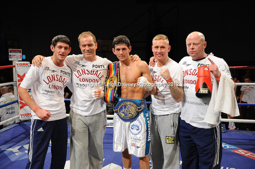 Jamie McDonnell (white shorts) defeats Ivan Pozo to retain the European Bantamweight Title, on 3rd March 2012 at the Hillsborough Leisure Centre. Frank Maloney & Dennis Hobson Promotions © Leigh Dawney Photography 2012.