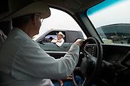 John L. Moore, Joe Peila, Joey Peila, planning cattle branding, neighbor, Lazy TL Ranch, north of Miles City, Montana