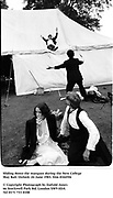 Sliding down the marquee during the New College May Ball. Oxford. 24 June 1983. film 83445f6<br />&copy; Copyright Photograph by Dafydd Jones<br />66 Stockwell Park Rd. London SW9 0DA<br />Tel 0171 733 0108