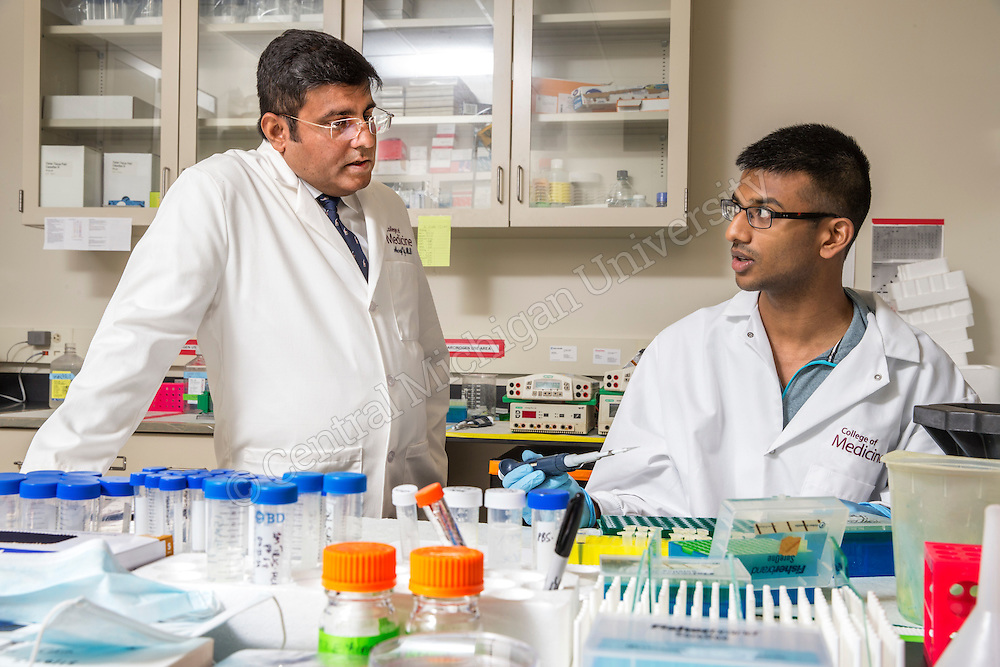 Dr. Neeraj Vij lab with CMED Second year medical student Viren Govindaraju, of Seattle, WA, in the medical research facility. Central Michigan University photos by Steve Jessmore