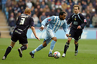 Photo: Leigh Quinnell.<br /> Coventry City v Leeds United. Coca Cola Championship. 18/03/2006. Coventrys Andy Impey makes his way between Leeds' Eddie Lewis(R) and Stephen Crainey.