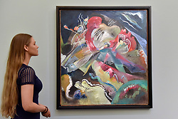 "© Licensed to London News Pictures. 15/06/2017. London, UK. A staff member views ""Bild mit weissen Linien"", 1913, by Wassily Kandinsky (estimate on request).  Preview of Impressionist and Modern art sale, which will take place at Sotheby's New Bond Street on 21 June.  Photo credit : Stephen Chung/LNP"