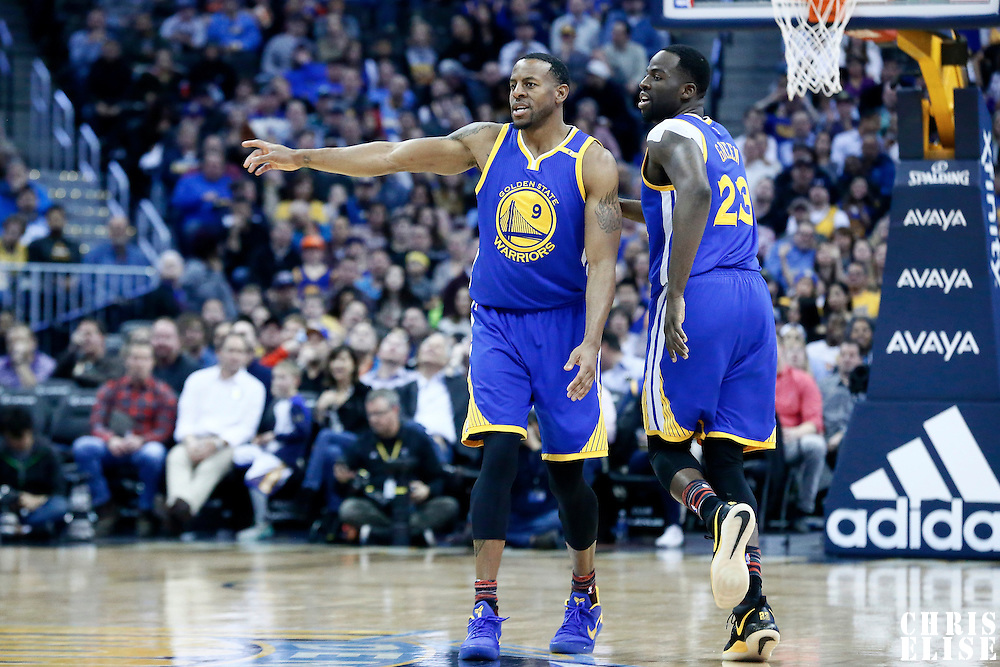 13 February 2017: Golden State Warriors forward Andre Iguodala (9) celebrates with Golden State Warriors forward Draymond Green (23) during the Denver Nuggets 132-110 victory over the Golden State Warriors, at the Pepsi Center, Denver, Colorado, USA.