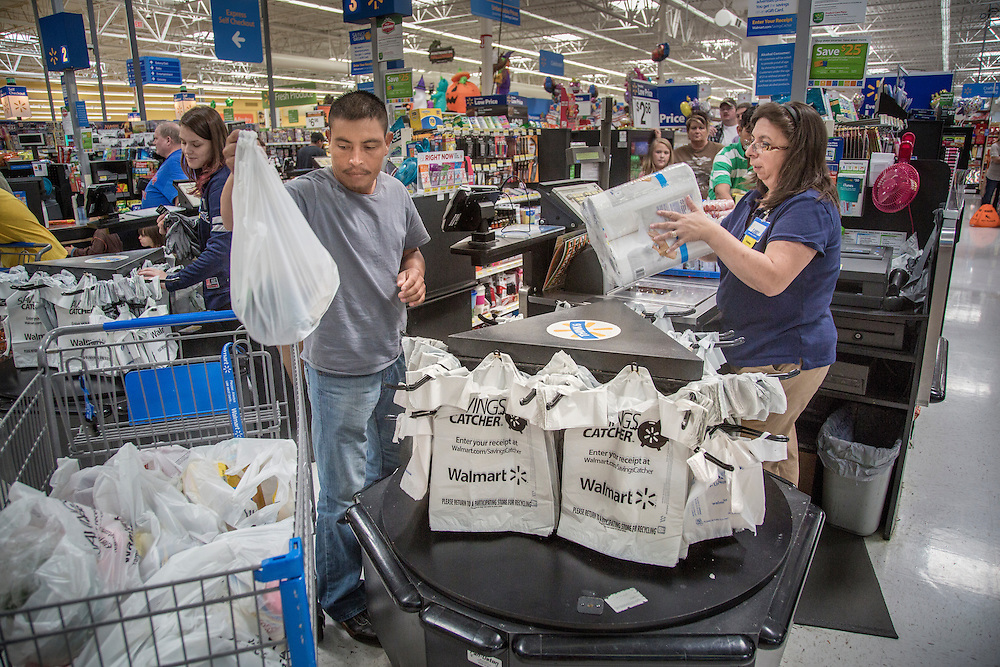 As the veteran among all other migrant workers on the farm, Santiago Garcia acts as the group's father by driving the others into Lafayette, Tennessee, for grocery shopping, lunch and to transfer money back to their families in Mexico. Nick Wagner / Alexia Foundation