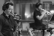 "Saxophonist Evan Cobb and trumpeter Matt White, in the studio recording Cobb's 2016 CD ""Hot Chicken."""