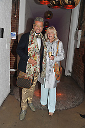 LIZ BREWER and EVGENI MINCHEV at a party to celebrate the Kelly Hoppen and Smallbone kitchen range held at The Collection, 264 Brompton Road, London on 24th September 2012.