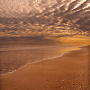 Altocumulus Clouds form at sunset over an empty Topsail Beach on the coast of NC.