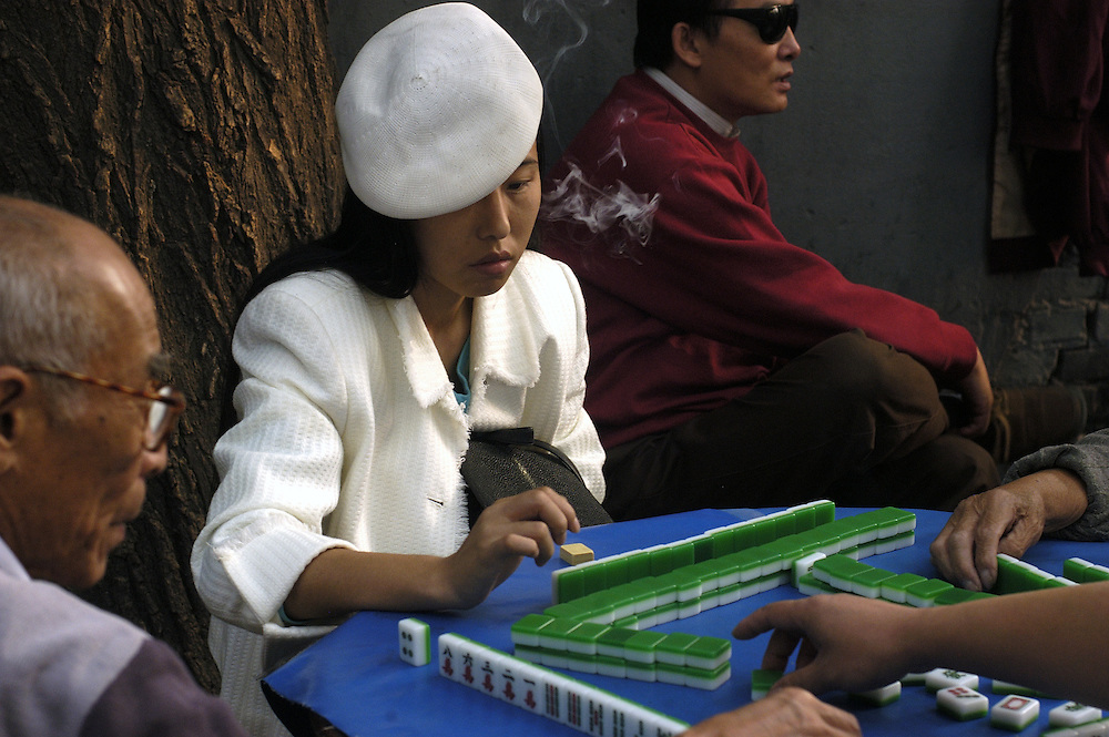 People play the traditional game of Mahjong in Beijing China September 2004