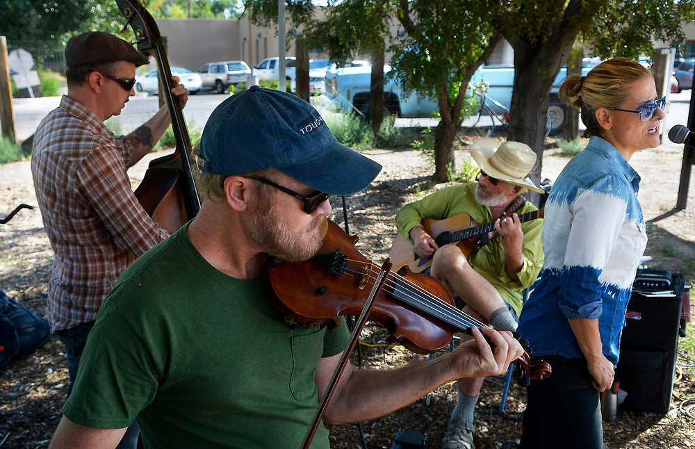 gbs073017p/ASEC -- Los Radiators members, Jared Putnam, Chris Carlson, Rick Dorin and Kat Bell, from left. perform at the Corrales Growers Market on Sunday, July 30, 2017. The band plays acoustic folk and blues.(Greg Sorber/Albuquerque Journal)