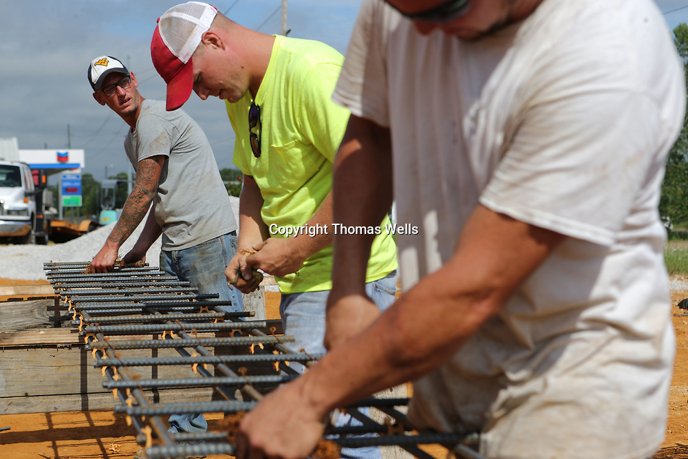 Southland Construction worker James Means, left, and fellow workers begin constructing sections of rebar that will be used or the footers of the Tupelo-Lee County Humane Society Animal Shelter that is under construction on Cliff Gookin Blvd. in Tupelo.